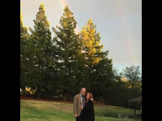 Standing at the end of a rainbow after a beautiful rainstorm cleared, just in time for a loved one's outdoor wedding!