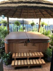 Our wonderful hot tub at 35'c in a tropical setting ... bliss