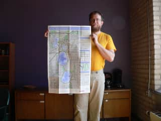 Nat shows off a map.