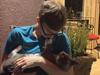 My son with our cat, Thundercloud.
