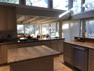 Our kitchen and adjoining family room, looking out to back yard.