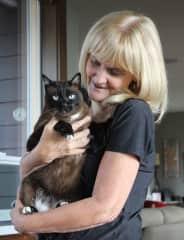 Karen, snuggling Simba at house sit in Bellingham