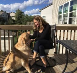 My golden, Fuzzy, with me on the deck enjoying the sunny afternoon.