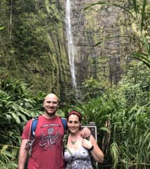 A beautiful waterfall at the end of a long tramp in Hawaii.