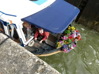 Trevor on our barge 'Manatee'.....going up in a lock.....2018.....we enjoy our little garden in the bow.