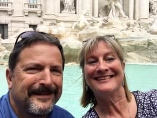 My husband and me at Trevi fountain in Rome