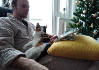 Vassili pet-sitting his parent's cat Dasha