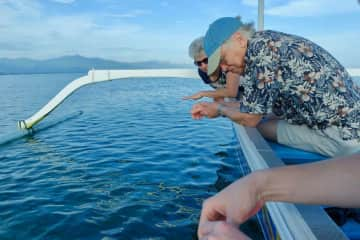 Marta and Phil talk about the fish beneath the surface of the water on field trip in Bali