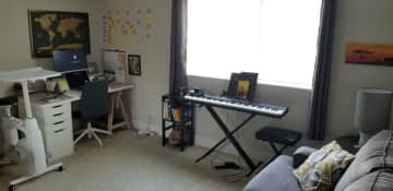 Guest bedroom has a desk set-up to work. Couch also pulls out into a bed, if guests prefer to sleep here.