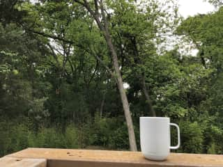 Enjoy your morning coffee among the trees and listening to the birds.
