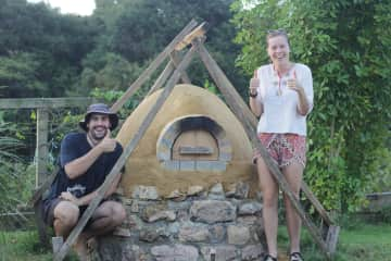 Lachlan and I after we finished our pizza oven. We also love making things and eating delicious food.