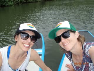 Julie and AJ on SUP boards in Hawaii.