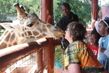 This is me at the Giraffe Reserve in Kenya.  2015.  Softest Tongue I have ever had licking my chin!