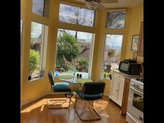 Small kitchen and eating area looking out at garden and Santa Rita Mtns.