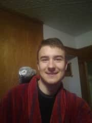 Jakub with his parrot