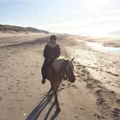 Ina horse-riding in Denmark.
