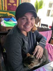 Summer stores up good cat karma everywhere she goes.  This stray jumped right into her arms for a warm nap.