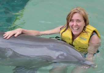With a mama dolphin in Cozumel, my favorite part of my one & only cruise