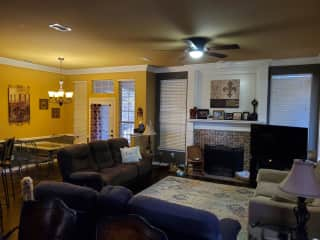Living room and dining area. Gas fireplace has to be manually lit.