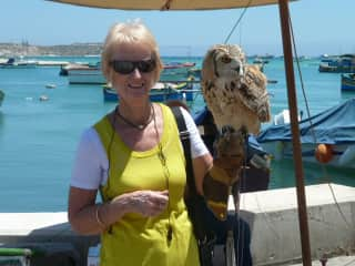 Barbara holding an owl while on holidays