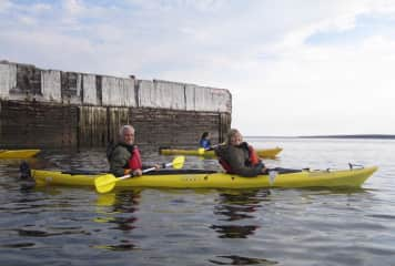 Ken and Laureen heading out to kayak with the beluga whales in Churchill