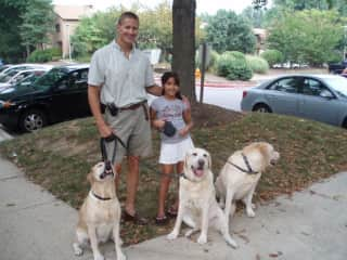 Nick with our niece, two of our pups on a play date with a neighbors lab.