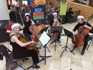 Performing holiday music with the Delphia Cello Quartet at the Minneapolis/St. Paul airport.