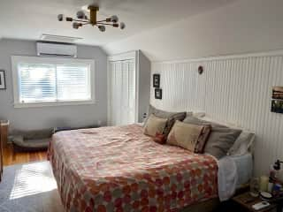 The master bedroom with a king bed, a/c and a full bathroom.