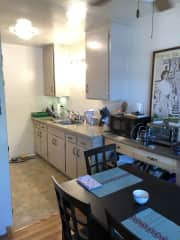 Kitchen with dining area. Full stove and oven, toaster oven and microwave