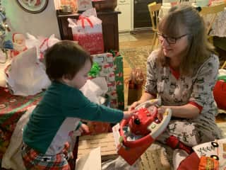 My grandson unwrapping a new toy.  2020