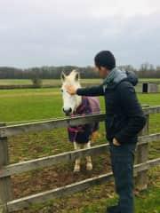 Lionel stroking pet sitting horse
