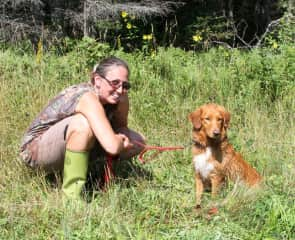 Tamara and Swede; after successfully passing and Titling in the Land, Tolling and Water Retrieves at a Northern Minnesota Hunt Test.