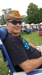 I travel internationally often, but not to run around.  I go to hang out, meet people, and enjoy the culture.  I travel locally to Blues festivals, like in this pic.  Love to ride my bicycles.