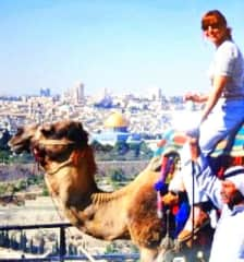Traveling abroad RIding a camel in Morocco