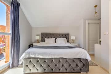 Bedroom nr 1 on the second floor with en-suite bathroom and a small terrace with nice sea views