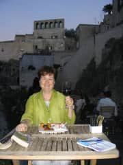 This is me enjoying a little Italian hospitality in Matera, a wonderful little town.