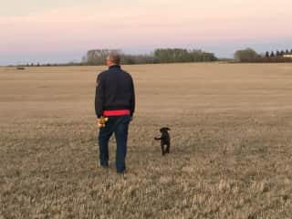 Doug with our new puppy walking in our field