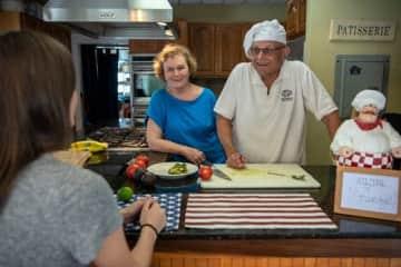 Lorenzo and Carolyn in their Culinary School kitchen