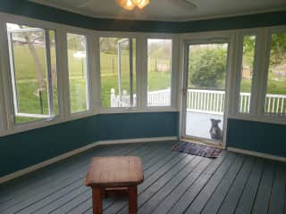 The sunroom (with bonus Juno) - we'll hopefully have more furniture there by your stay!