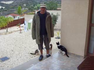 Greg in the garden with our Cyprus strays, Clint, Kenneth and Matron. Obviously it's their garden not ours.