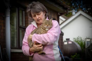 Margaret with Cassie, our beloved and super friendly little cat who chose us one day for her forever home.  Dearly loved by us all and many visitors and guests to our home.