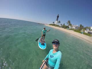Christine (in the back) paddle boarding in Lighthouse Point, FL