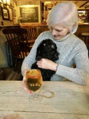 Me with Nina, a sweet Cavapoo, in a dog-friendly pub in Stow on the Wold, UK