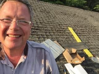 Selfie fixing a barn roof