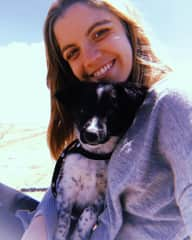 Vicky in Pinamar, Argentina with her dog Wiesel.