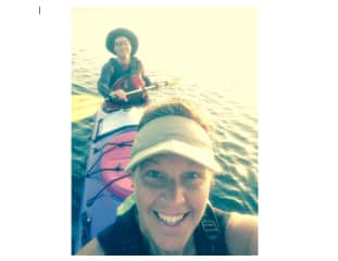 Diane and Jeff sea kayaking on Lake Superior.  We love the outdoors and being active.