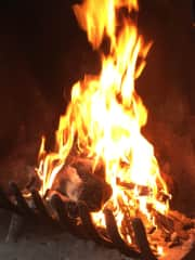 I love fireplaces, or outside sitting beside a bonfire.