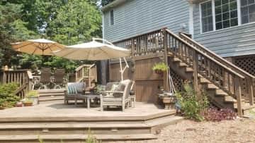 The large, multi-level deck in the backyard.