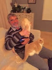 Richard with 2 of the 8 kitties in Spain.