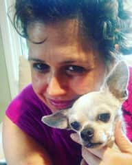 Me with Buster the Chihuahua who I did Reiki healing treatments on weekly for over 2 years